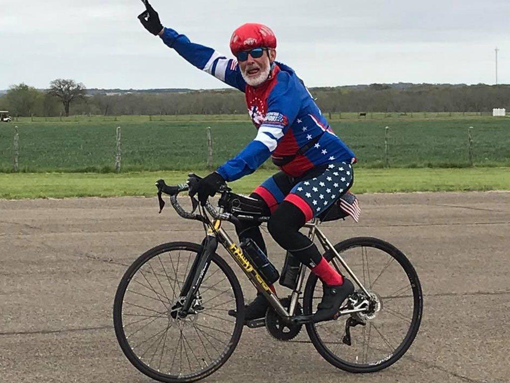 Frank smiling big on the bike